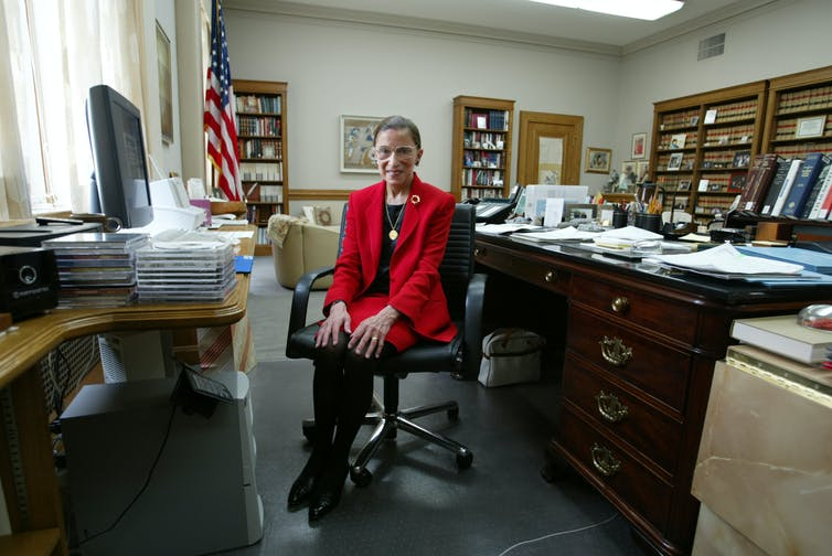 Supreme Court Justice Ruth Bader Ginsburg sitting in her chambers in 2002.