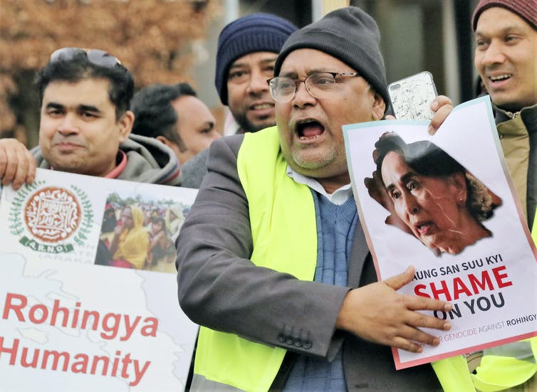 Critics protested against Myanmar leader Aung San Suu Kyi outside the International Court of Justice in The Hague, during a case brought by Gambia alleging Myanmar has committed genocide against the Rohingya Muslim minority.