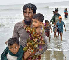 Rohingya refugees arriving by boat near Cox's Bazar, Bangladesh in 2017.