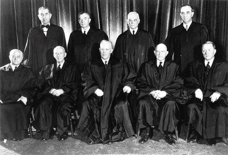 Nine US supreme court justices under Earl Warren wearing their robes.