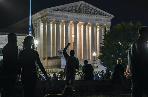 People gather outside the U.S. Supreme Court building