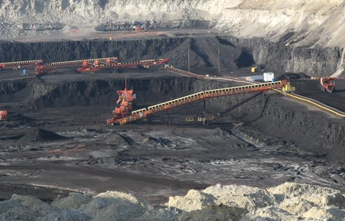 Large coal pit with excavating machinery