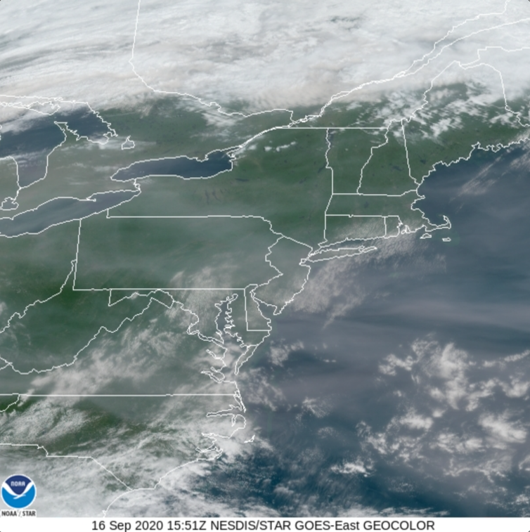 A satellite photo of the Eastern U.S. with a haze of smoke visible.