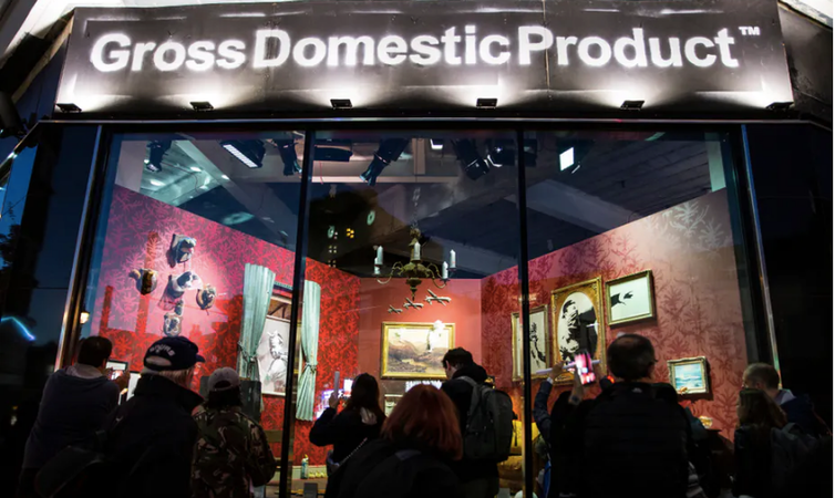 Image of Gross Domestic Product a shop window in Croydon showing graffiti artist Banksy's merchandise.