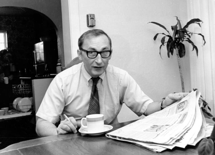 Mike Royko, having breakfast and a cigarette.
