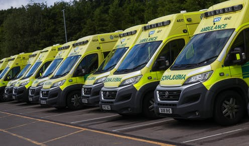 A row of parked ambulances