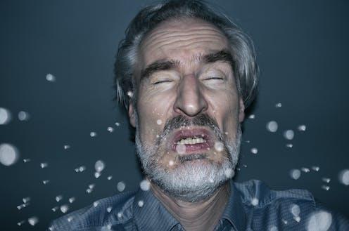 Illustration of a man sneezing