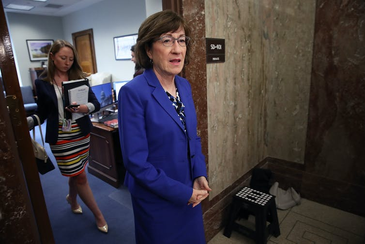 Sen. Susan Collins in a marine blue suit.