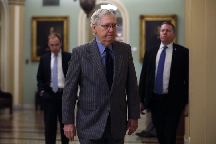 Senate Majority Leader Mitch McConnell, walking into a meeting.