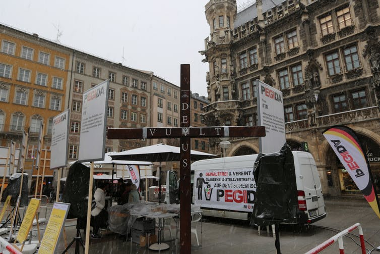 A crusader cross on display at a rally by the racist Pegida movement in Germany