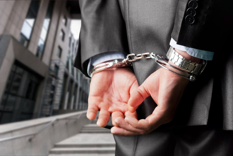 Picture of a man in handcuffs.