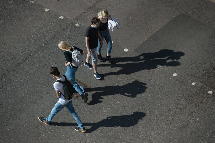 An aerial view of students walking in different directions.