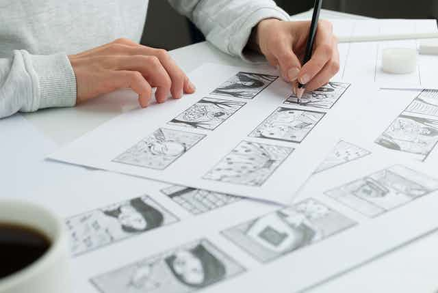 Artist draws story frames