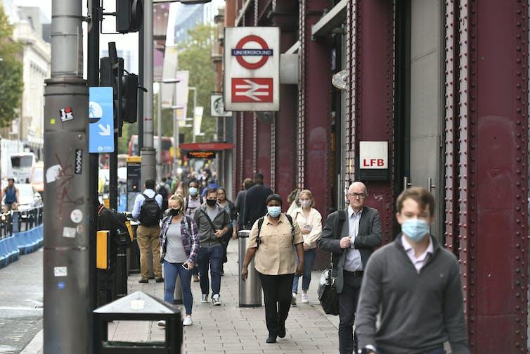 Pedestrians outside Waterloo Station in London
