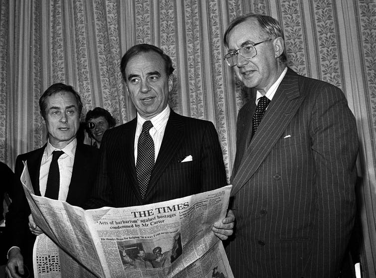 Harold Evans, Sunday Times Editor; New owner and Australian press magnate Rupert Murdoch and William Rees-Mogg, The Times Editor.