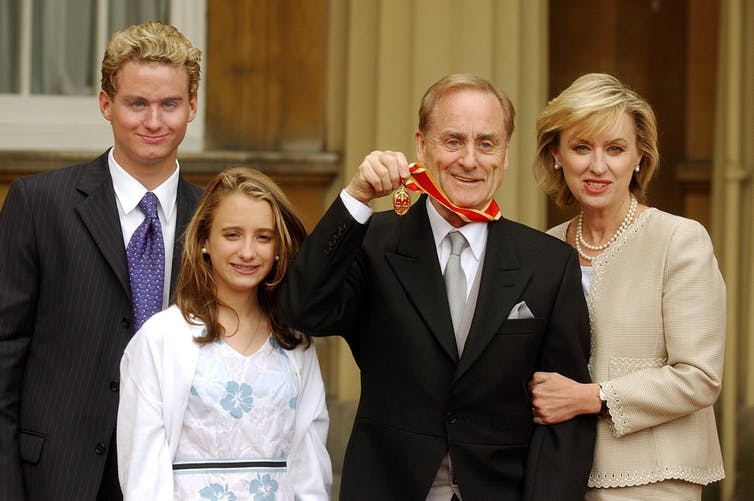 Harold Evans and his wife Tina Brown and two teenage children outside Buckingham Palace.