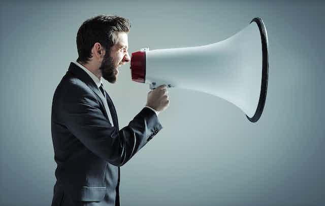 Man shouts into massive megaphone