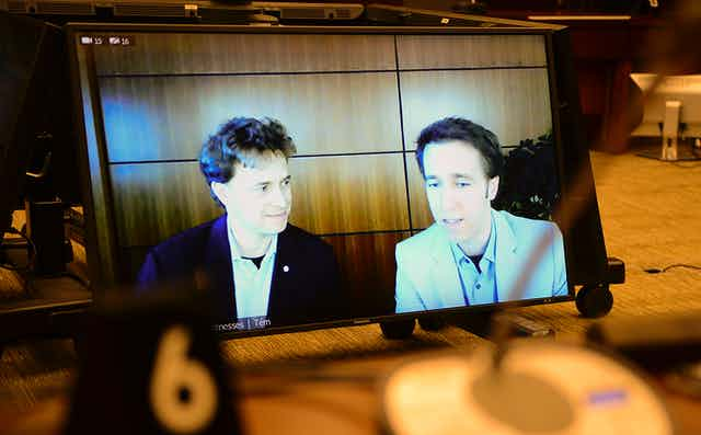 WE Charity's Marc Kielburger, left, and Craig Kielburger, right, appear as witnesses via videoconference