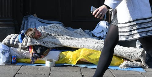 A person sleeping rough on a city street