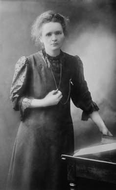 A black and white photograph of Marie Curie