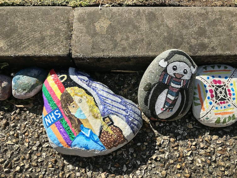 Colourful designs painted on pebbles