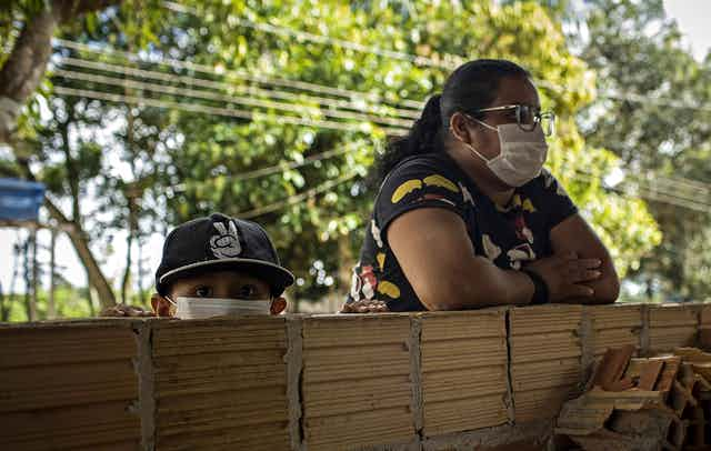 A woman and her young son wearing masks in Manaus, Brazil.