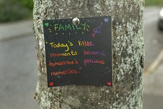 Note of positivity pinned to a tree