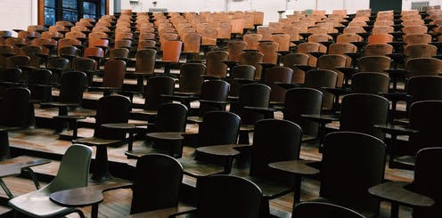 Lecture hall with empty desks.