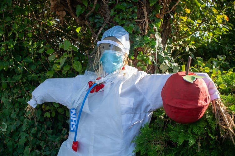 Scarecrow dressed as an NHS worker