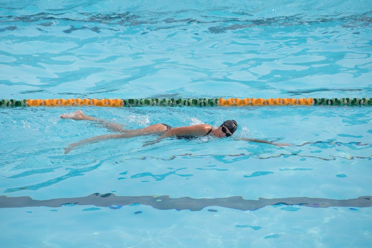 A person swims laps in a pool.