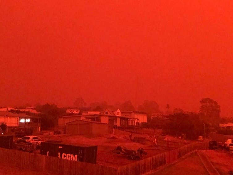 A sky looks red due to bushfire smoke.