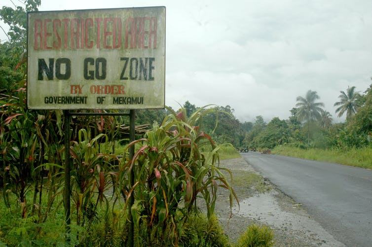 A sign by the road that reads 'no go zone'.