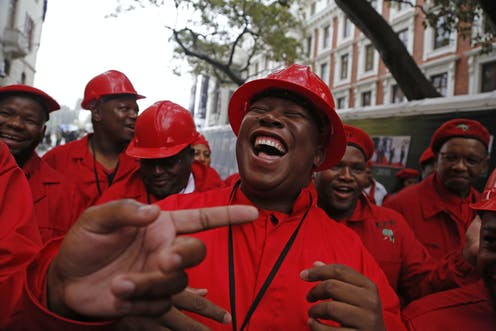 Julius Malema, leader of South Africa's Economic Freedom Fighters, and members of his party outside parliament.