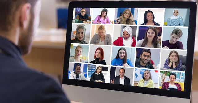 A videoconferencing screen with many faces.