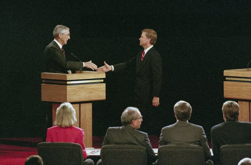 Bentsen and Quayle shake hands on the debate stage