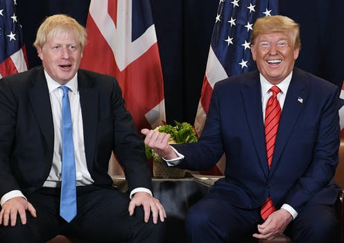 Donald Trump laughing at Prime Minister Boris Johnson.