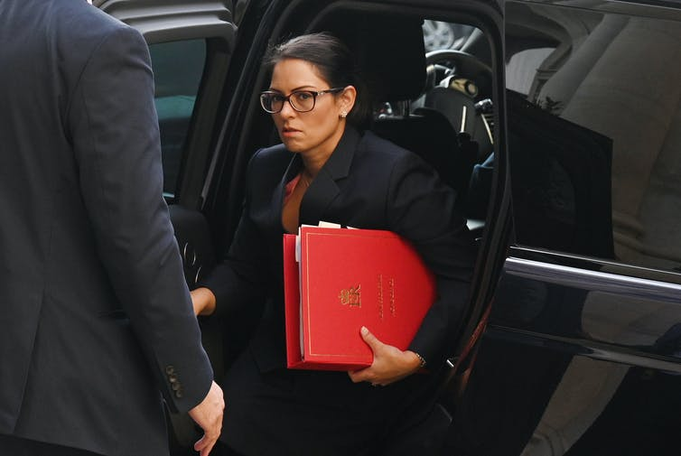 Priti Patel getting out of a car.