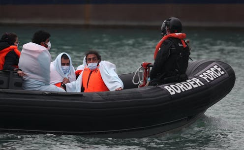 A Border Force boat brings people ashore in Kent.