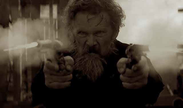 John Brown fires two pistols in a scene from the TV miniseries.