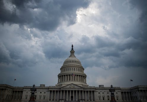 Clouds gather over the U.S. Capitol building.