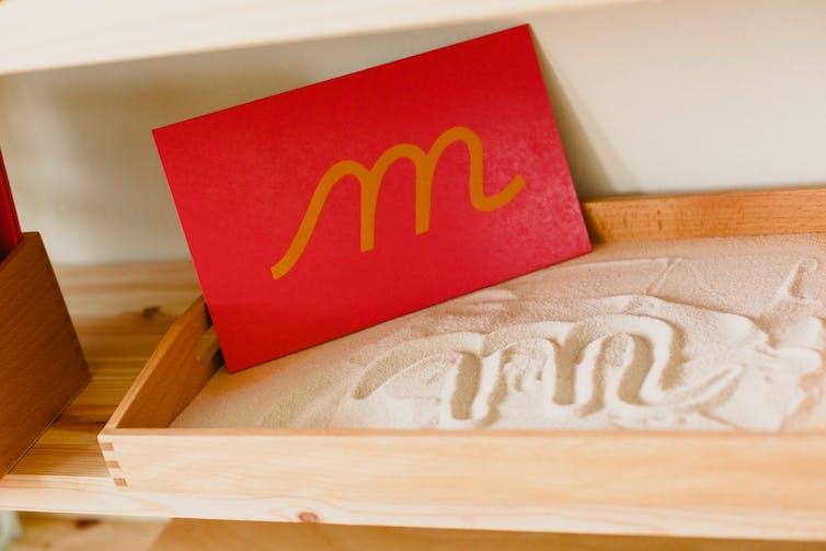 Montessori-style sandpaper letter 'M'