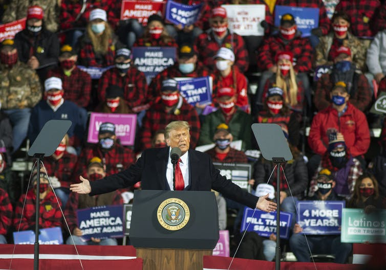 Trump thrives on rallies but won't be able to attend them for at least a couple of weeks. AAP/AP/ Jack Rendulich