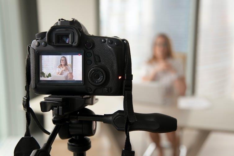Camera recording woman talking