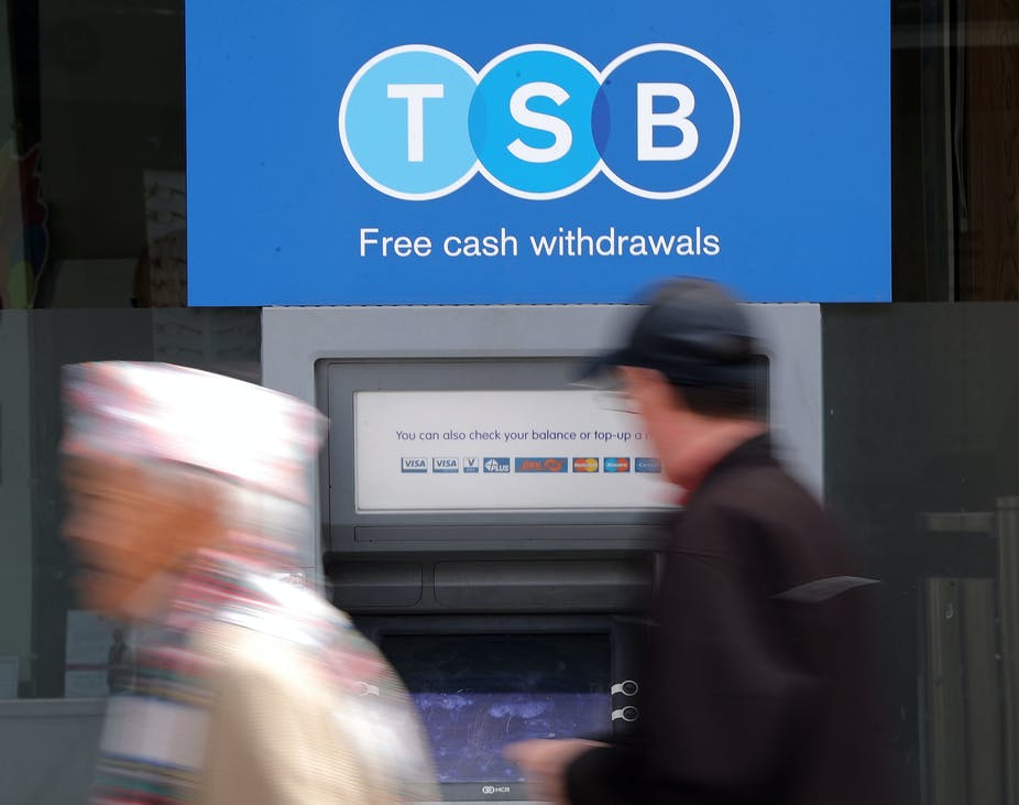 Two people outside a TSB ATM