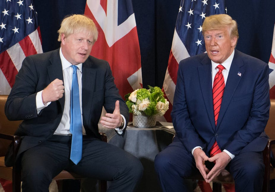 Boris Johnson and Donald Trump sitting with UK and US flags behind.