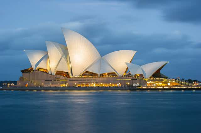 Photo of the Sydney Opera House against a stormy sky