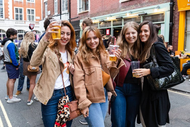A group of women socialising on a street in London