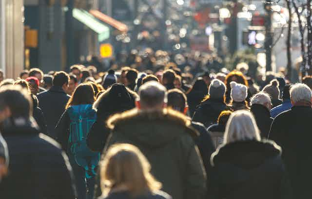 A crowded street, filled with pedestrians