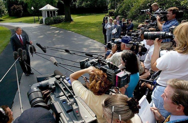 President George W. Bush speaking to the press.