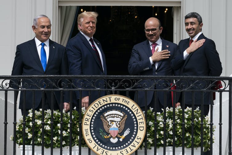 Israeli Prime Minister Benjamin Netanyahu, left, President Donald Trump, Bahrain Foreign Minister Khalid bin Ahmed Al Khalifa and United Arab Emirates Foreign Minister Abdullah bin Zayed al-Nahyan stand together on a balcony.